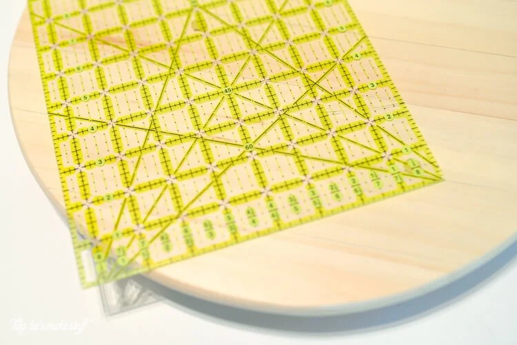 "Take a simple IKEA ""SNUDDA"" Lazy Susan and dress it up with @frogtape and paint! A fun, geometric DIY."