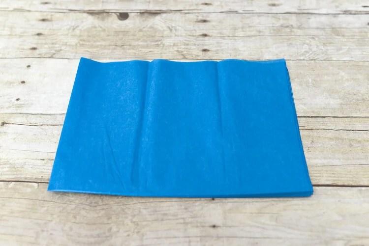 make tissue paper fireworks - fold tissue paper in half again