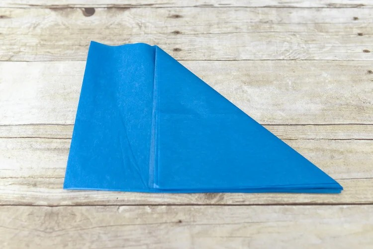 make tissue paper fireworks - fold the corner piece to the edge to create a triangle