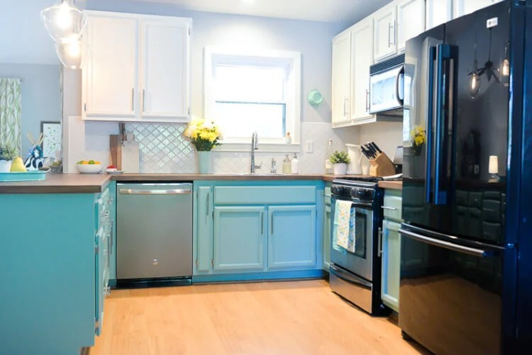updated kitchen with painted teal cabinets