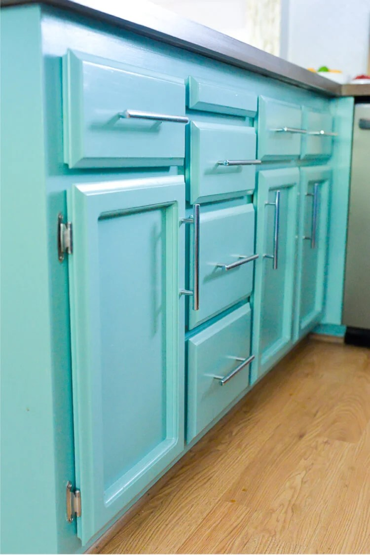 Get a perfect finish on your cabinets by taking the time to paint them right! Here's everything you need to know about painting your solid wood cabinets.