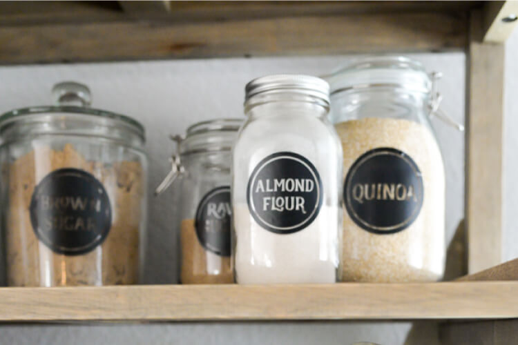 Organize your pantry with these vinyl pantry labels! Download the free SVG files and cut them out on your Cricut Explore or other electronic cutting machine.