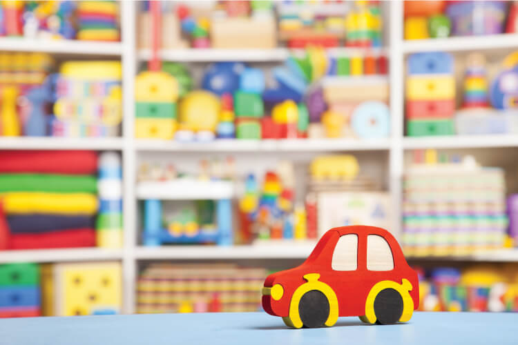 Learn how to declutter and organize toys for real families. A happy medium between minimalism and having too much stuff.