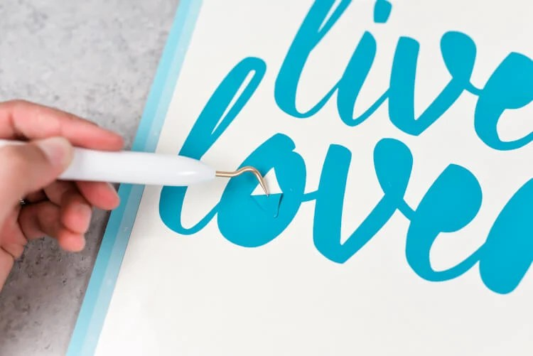 Weeding Vinyl - How sure how to use transfer tape? Here's how to get professional results for your vinyl projects, plus tips and tricks for getting it perfect.
