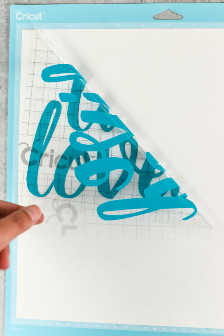 Peeling away transfer tape - How sure how to use transfer tape? Here's how to get professional results for your vinyl projects, plus tips and tricks for getting it perfect.