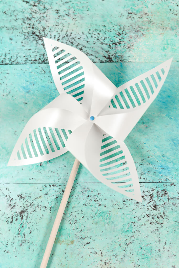 White Patriotic Pinwheel. Get the free SVG/DXF cut files for these decorative patriotic pinwheels! Delicate cut-outs made using your Cricut Explore make these star-spangled pinwheels a hit at any 4th of July party.
