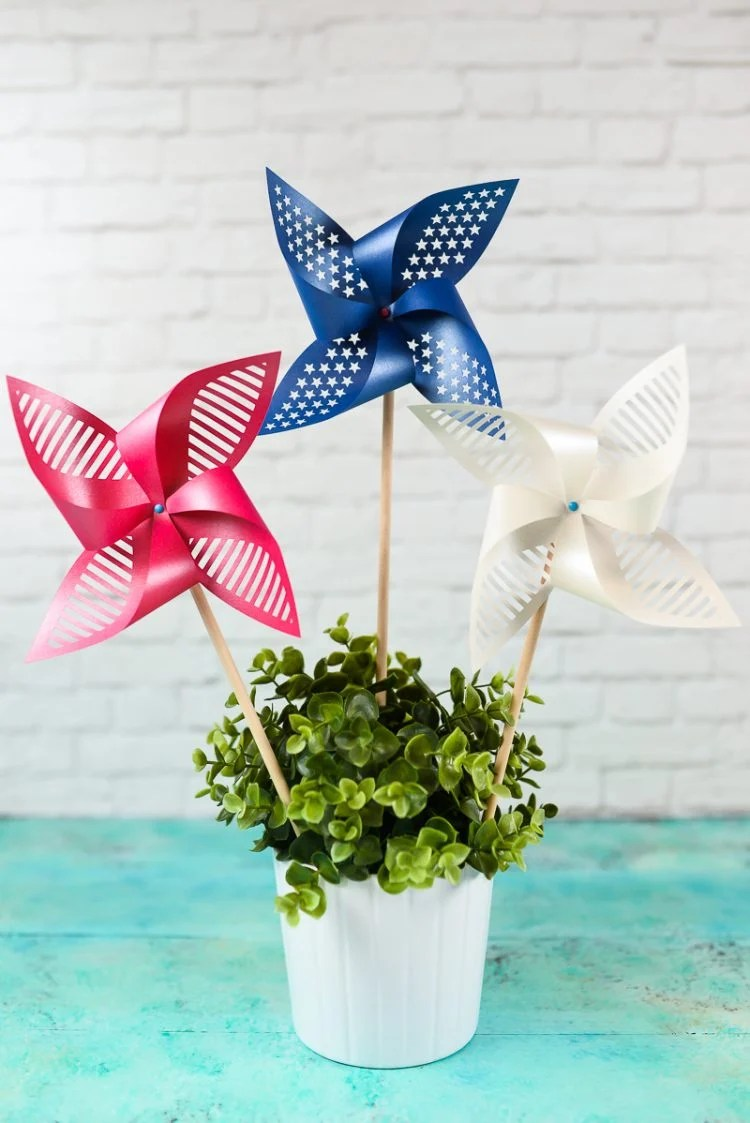 Patriotic Pinwheels styled as a centerpiece. Get the free SVG/DXF cut files for these decorative patriotic pinwheels! Delicate cut-outs made using your Cricut Explore make these star-spangled pinwheels a hit at any 4th of July party.