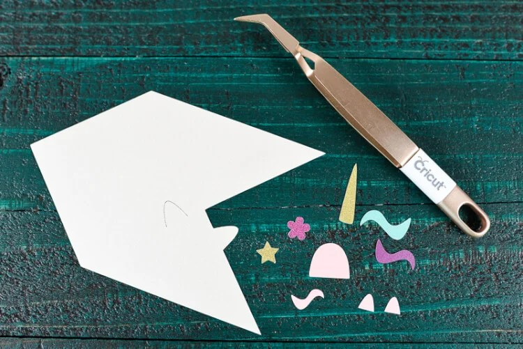 Cut out the Unicorn bookmark pieces on your Cricut - Make these adorable little unicorn bookmarks! The perfect craft for any time you're diving into a particularly whimsical book. A FREE SVG and DXF download.
