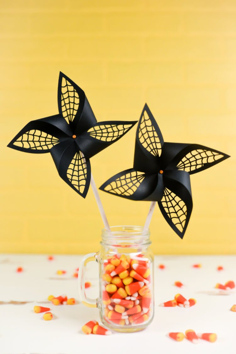Get the SVG cut files for these Halloween spider web pinwheels! Delicate web cut-outs make these spooky pinwheels a hit at any Halloween party.