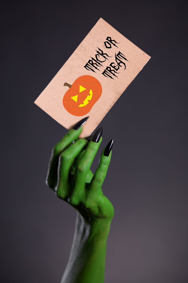 Image of a witch hand holding an invitation card with the free files