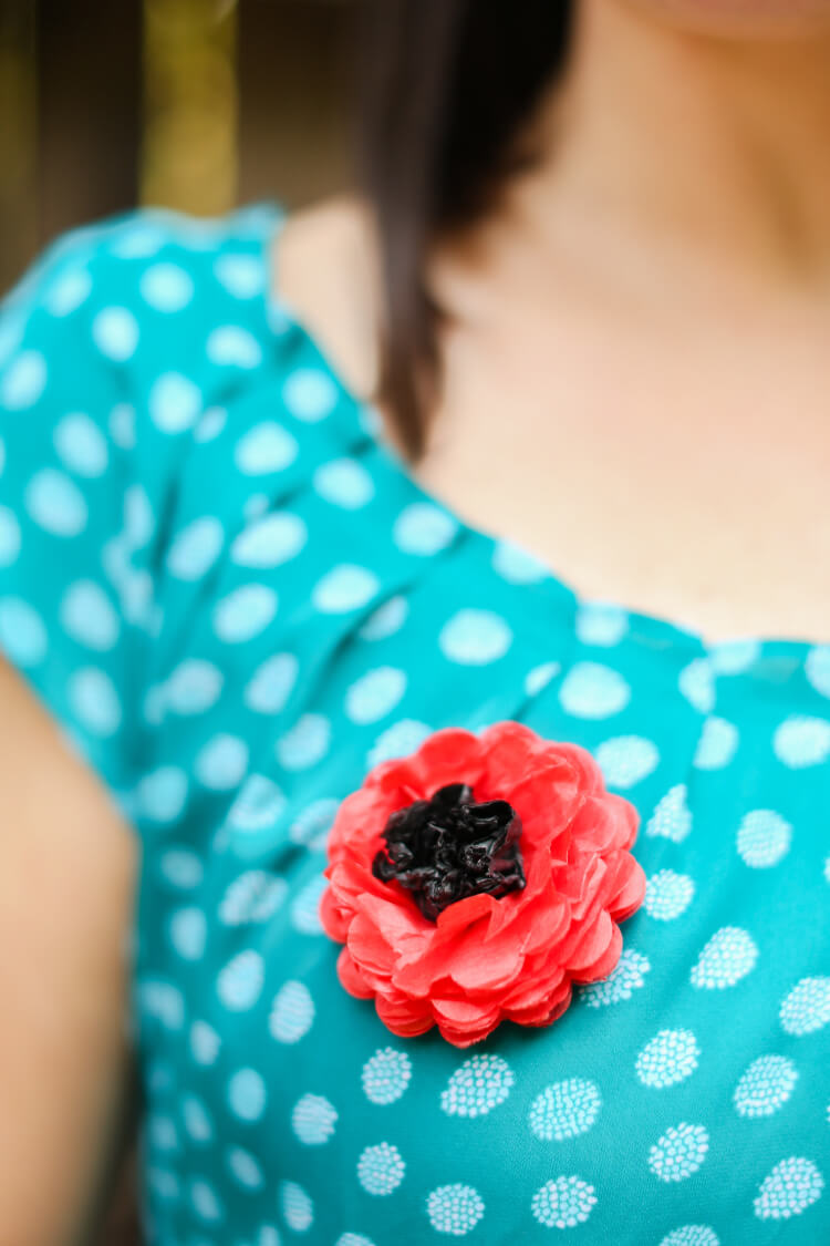 Red poppies, often worn on Memorial Day and Veterans Day, symbolize the sacrifices made by soldiers in the fight against Germany in WWI, as well as in subsequent wars. Make this simple tissue paper poppy pin to wear this year.