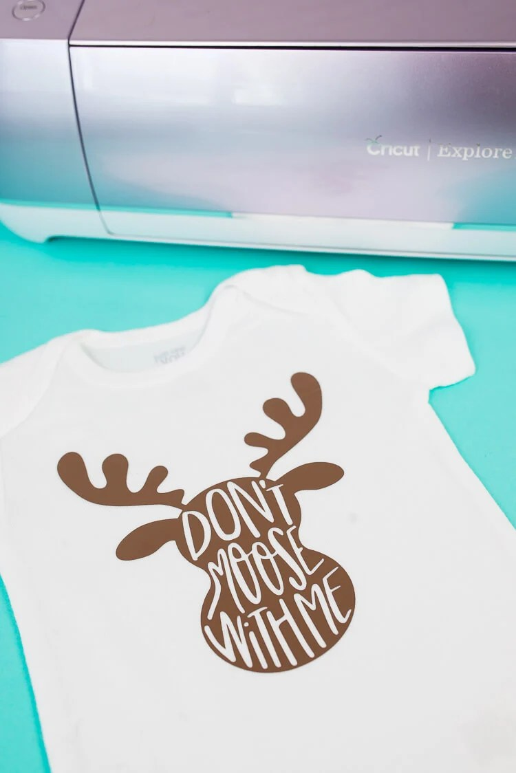 Tell everyone who's boss with this adorable moose onesie! This cute moose SVG is perfect for iron on onesies, as well as kids' t-shirts. Make it using your Cricut and get tips and tricks for using the Cricut EasyPress as well!