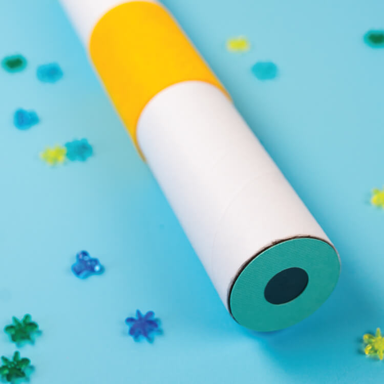 Transform ordinary Cricut supplies into a magical DIY kaleidoscope! This project is a fun way to use some unconventional Cricut materials and is a good way to teach kids about recycling!