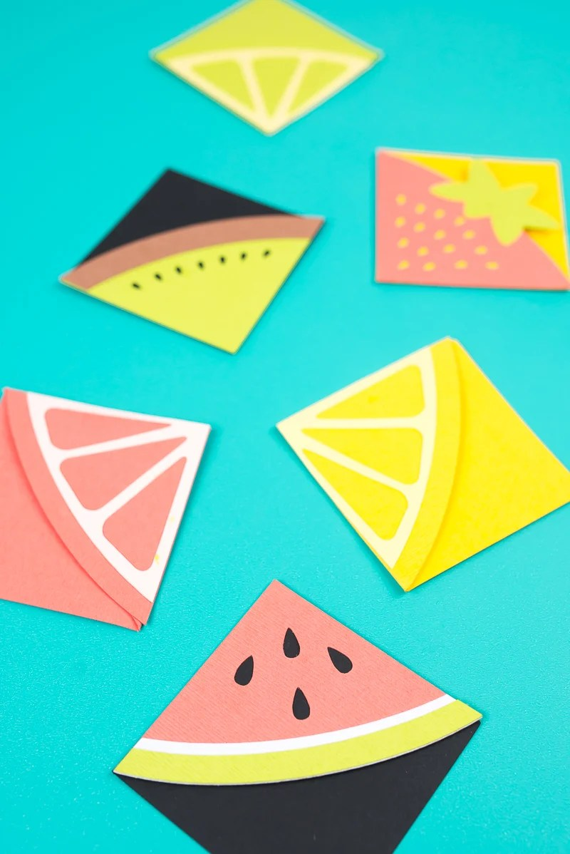Make these cheerful fruit bookmarks on your Cricut! These DIY bookmarks are perfect for summer, when you're diving into a delicious beach read.