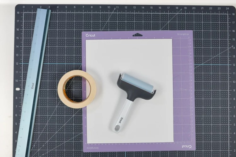 Use a brayer to adhere the matboard to your mat