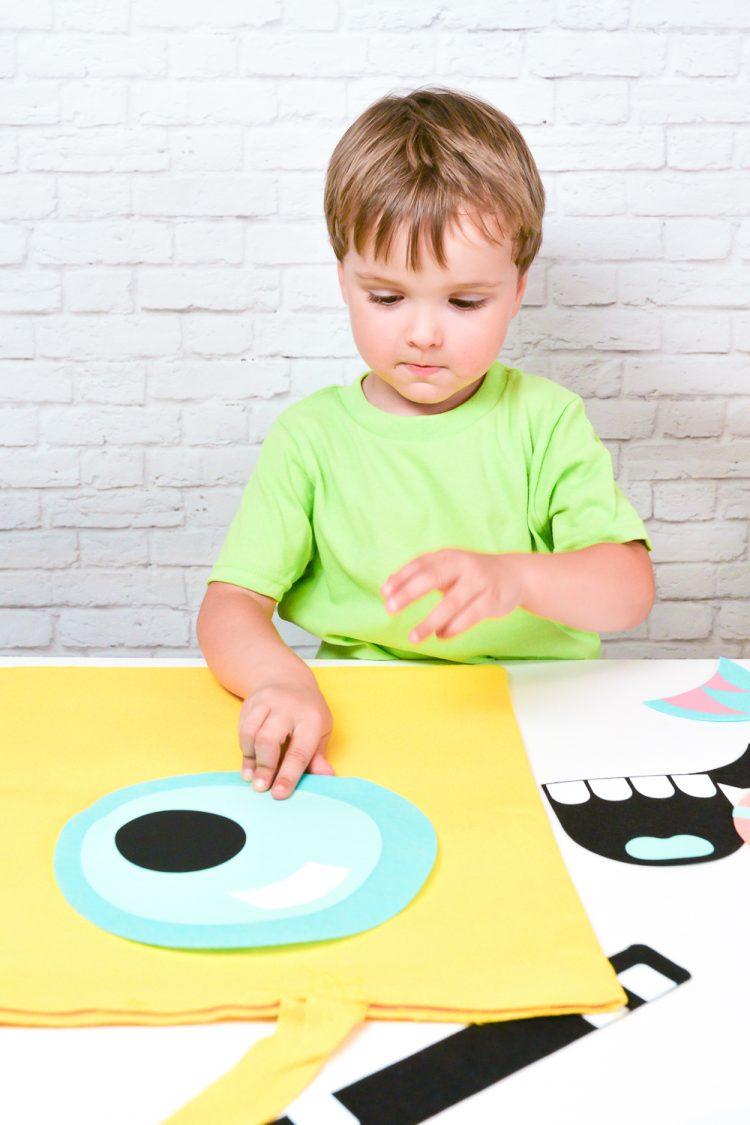 Kid Making a Monster Treat Bag
