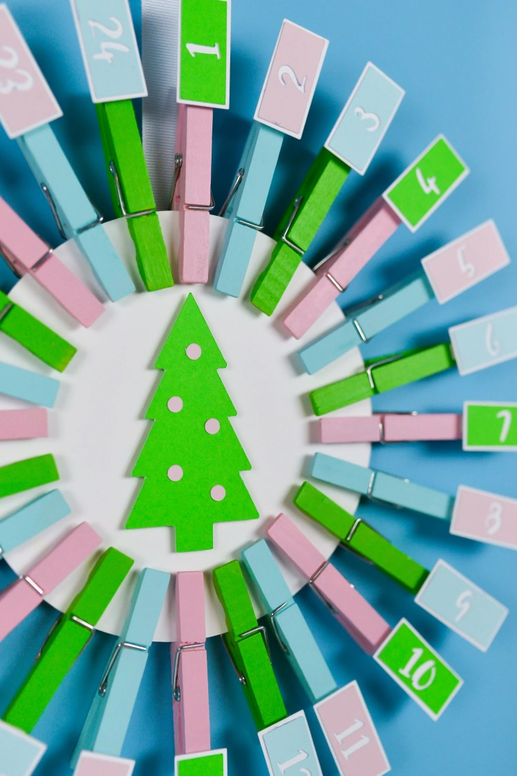 With a few materials from JOANN and your Cricut Explore or Maker, you can create this easy DIY Advent Calendar with Christmas activities! Your family will love counting down the days until Christmas!