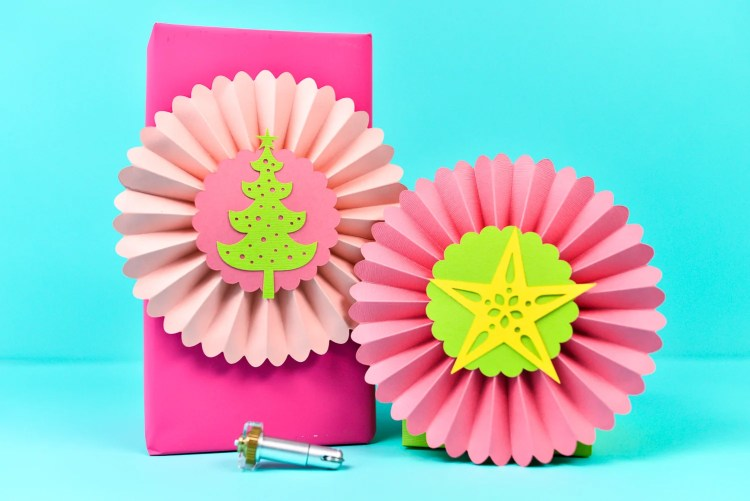 Create these gorgeous paper rosettes for Christmas -- perfect for gifts and decor.