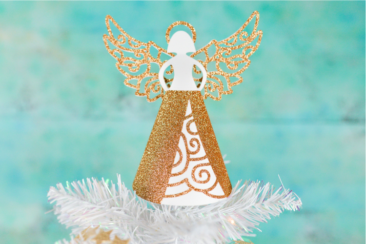 Add a handmade element to your tree with this gorgeous (but easy to make!) paper angel Christmas tree topper! Cut using your Cricut and assemble in less than 15 minutes!