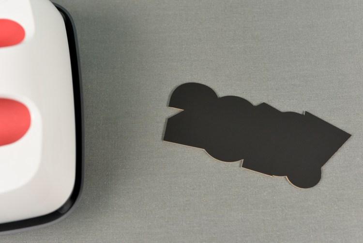 Iron on vinyl adhered to chipboard