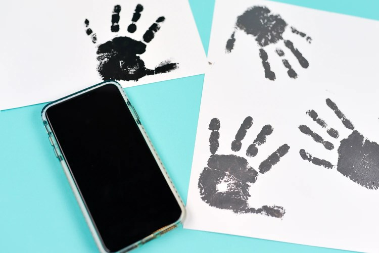 Take a photo of the handprints using your mobile phone.