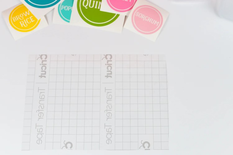 Cut one large piece of transfer tape and place sticky-side up on your work surface.