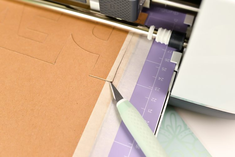 Just carefully wedge the blade between the cut line and gently lift up to see if your cuts have gone all the way through.