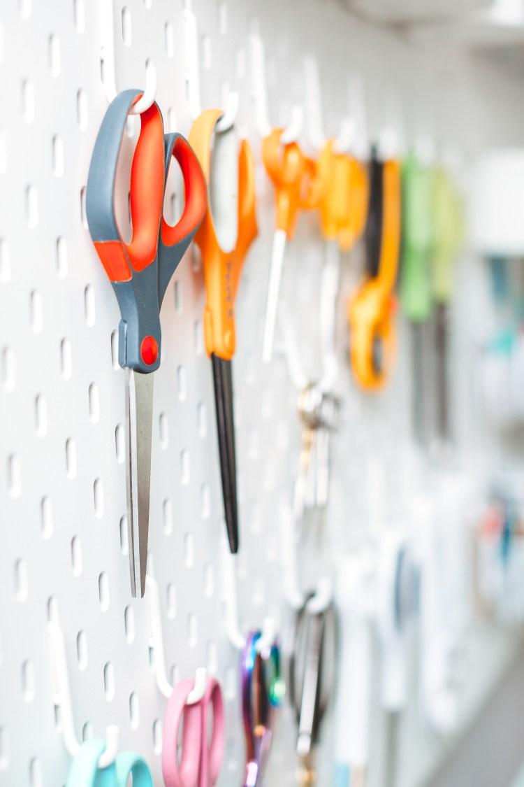 IKEA SKADIS pegboard holding scissors—great craft room organization!