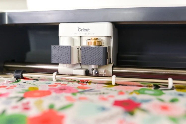 Cricut Maker cutting fabric with the rotary blade.