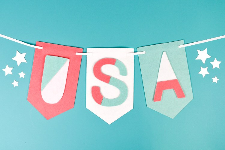 Need a quick 4th of July craft idea? This modern felt USA banner is the perfect patriotic decor! Cut out of felt by hand or with your Cricut—you can make it in 15 minutes or less!