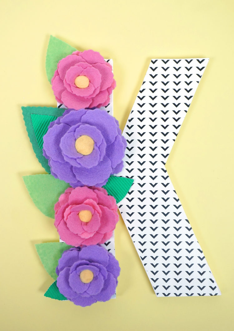 Dress up this DIY Floral Monogram Letter and it makes the perfect bridal shower gift. happinessishomemade.net shows us how to create a customized gift celebrating the bride's new last name.