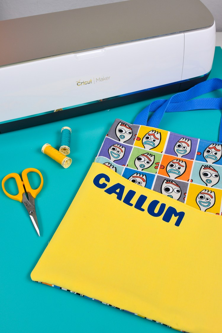 Then get the directions to make this easy-sew tote bag with the Cricut Maker using the rotary blade, and then personalize using iron on vinyl!