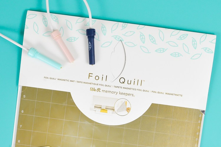 Beauty shot of the Foil Quill Magnetic Mat on a table with the three Foil Quill tips.