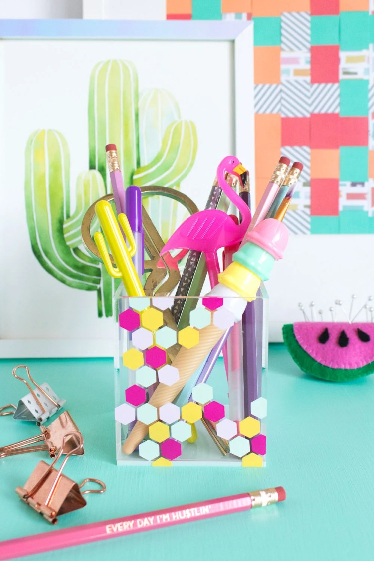 Give your pens and desk goodies a cute little home! Clubcrafted.com shows you how to make this colorful honeycomb acrylic organizer.