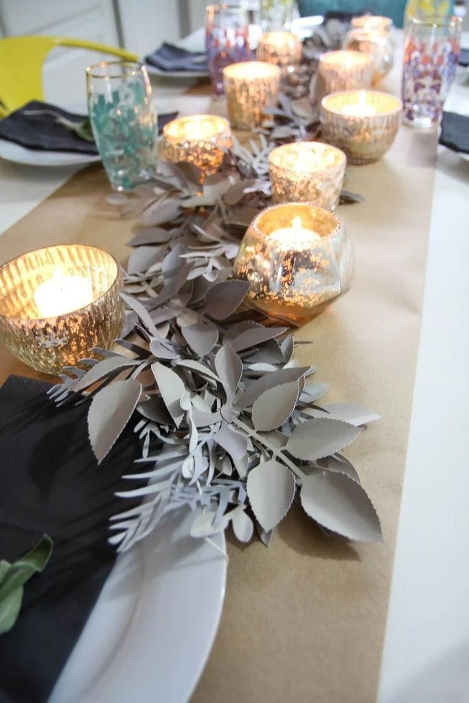 This DIY table runner is perfect for any season, any party, any gathering and just about any style of home, check out how momadvice.com puts it all together using her Cricut.