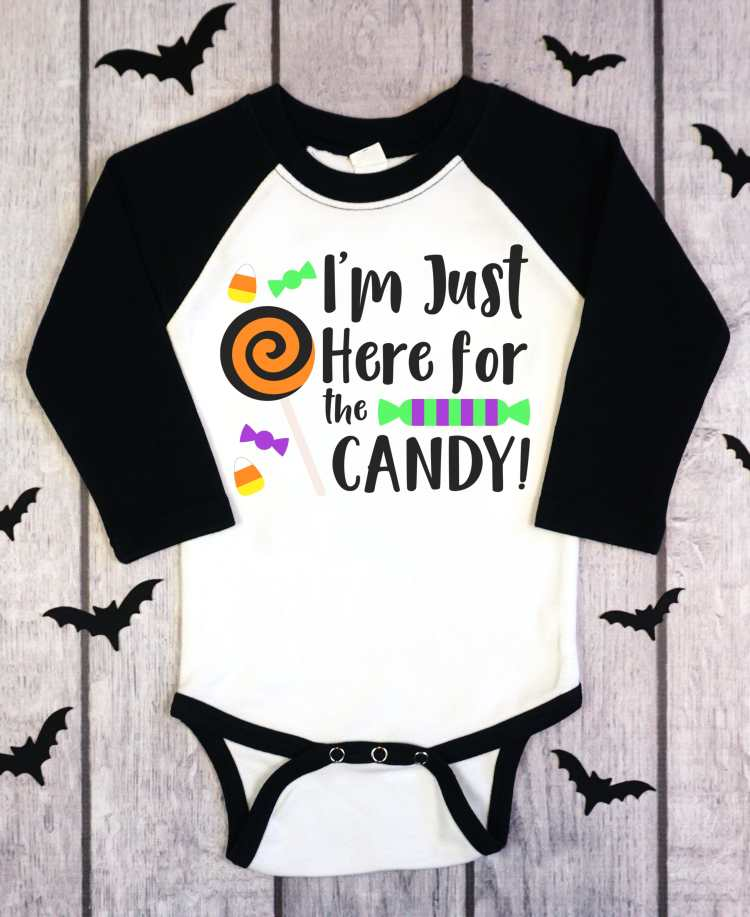 Even your littlest trick-or-treater can get in on the phone with this colorful and adorable I'm just here for the candy SVG from happinessishomemade.com.