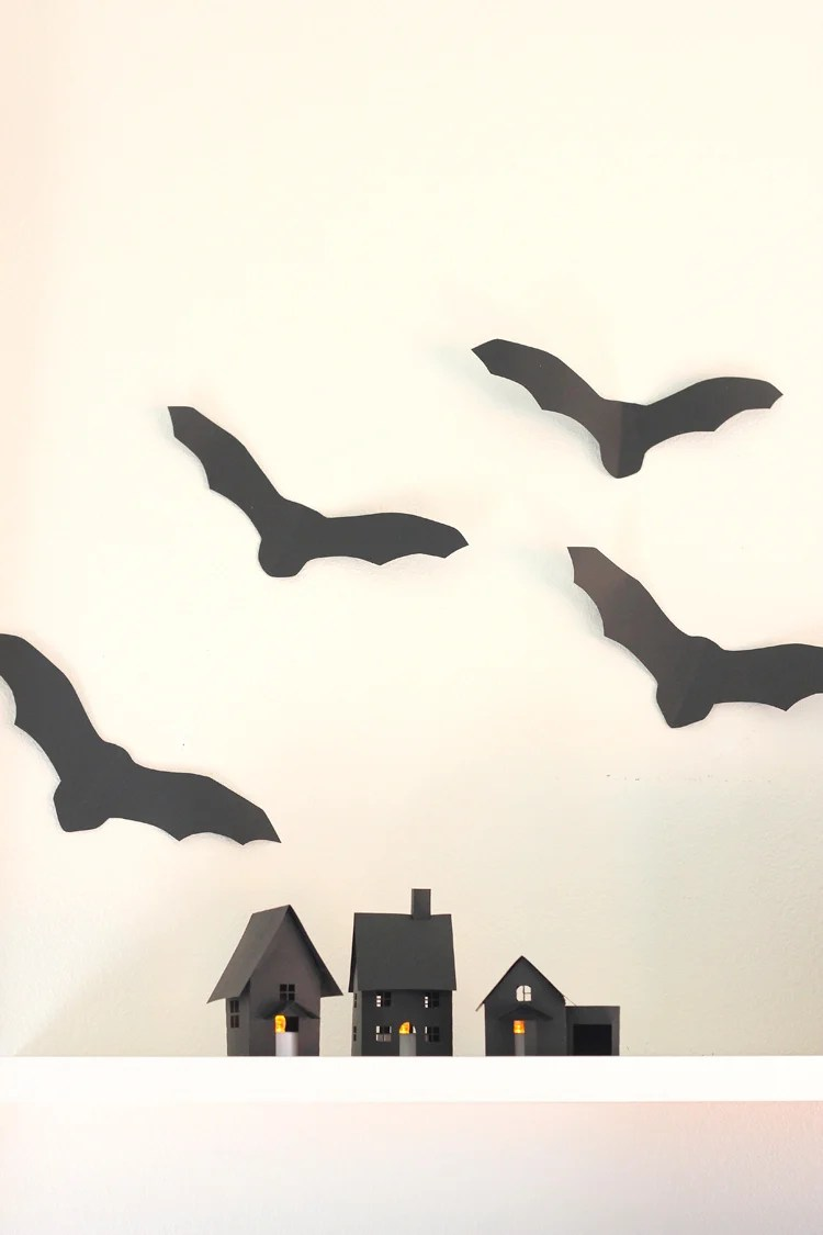 Set up your own spooky Halloween village with these DIY Paper Halloween houses from deliacreates.com.