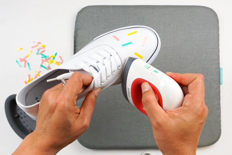 Use the EasyPress Mini to adhere the sprinkles to the shoes.