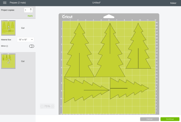 Prepare screen with felt Christmas trees on two mats.