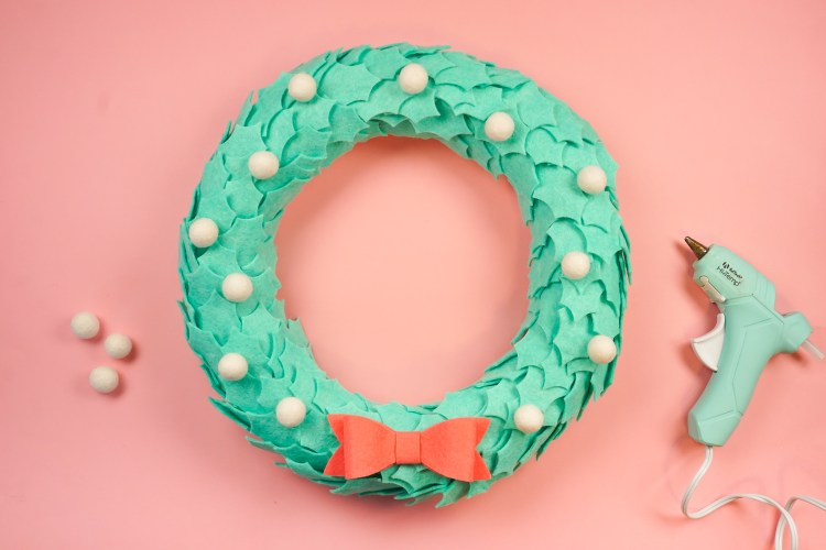 glue the felt balls to the wreath