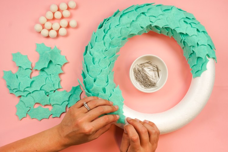 Pin your leaves to the wreath form.