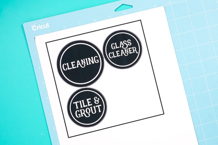 Place your printed labels on a Cricut cutting mat.
