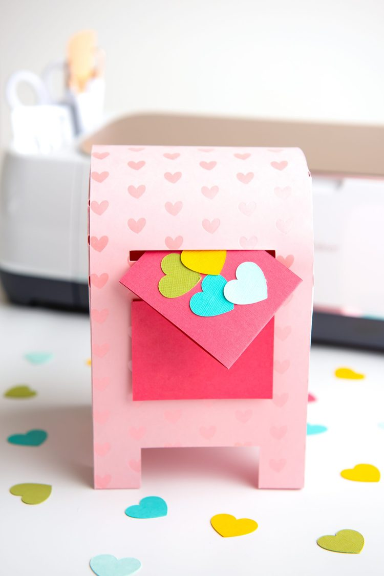 Use your Cricut Explore or Cricut Maker to craft this Valentine's Day box! Use the free SVG files and tutorial to make this adorable mailbox—perfect for storing valentines or as Valentine's Day decor!