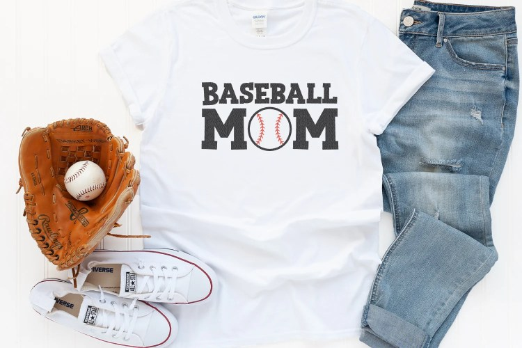 Baseball Mom SVG on a white t-shirt with baseball glove and jeans