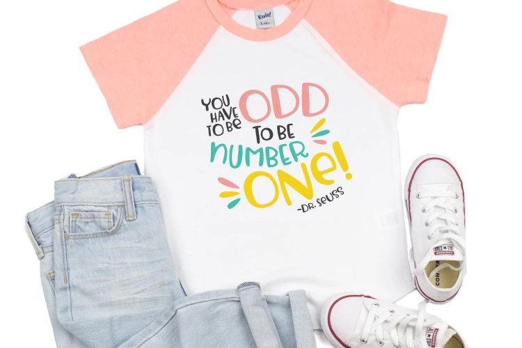 """You have to be odd to be number one!"" SVG on a pink raglan shirt."