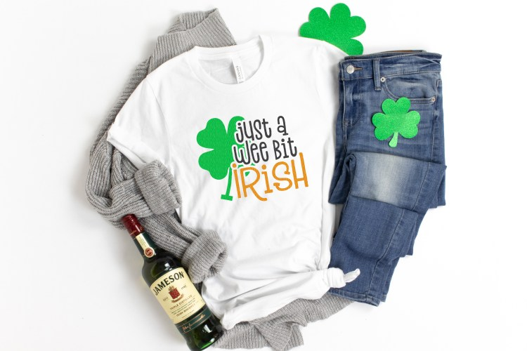 """Just a Wee Bit Irish"" svg file on a t-shirt with shamrocks and a bottle go Jameson"