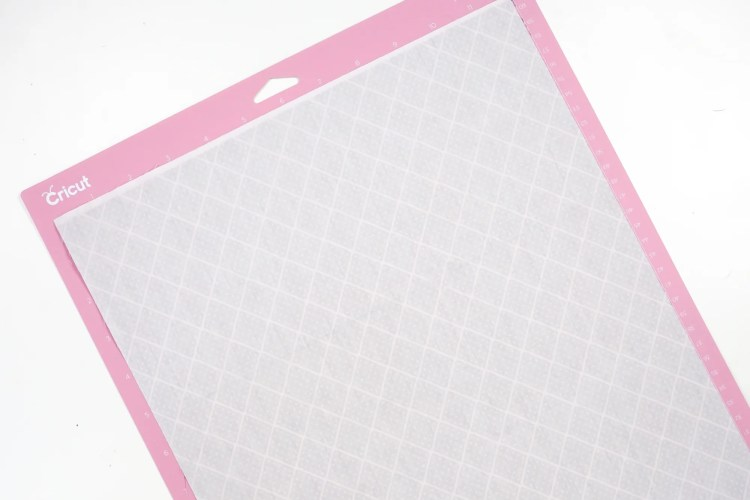 Place your fabric face-down on a Cricut mat.