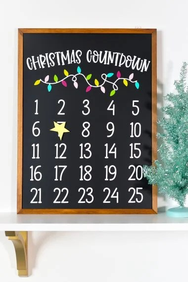 Mark the days until December 25 with this DIY Christmas countdown calendar! Use your Cricut Explore or Maker to craft this cute magnetic advent calendar!