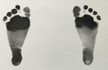 Phone image of newborn footprints