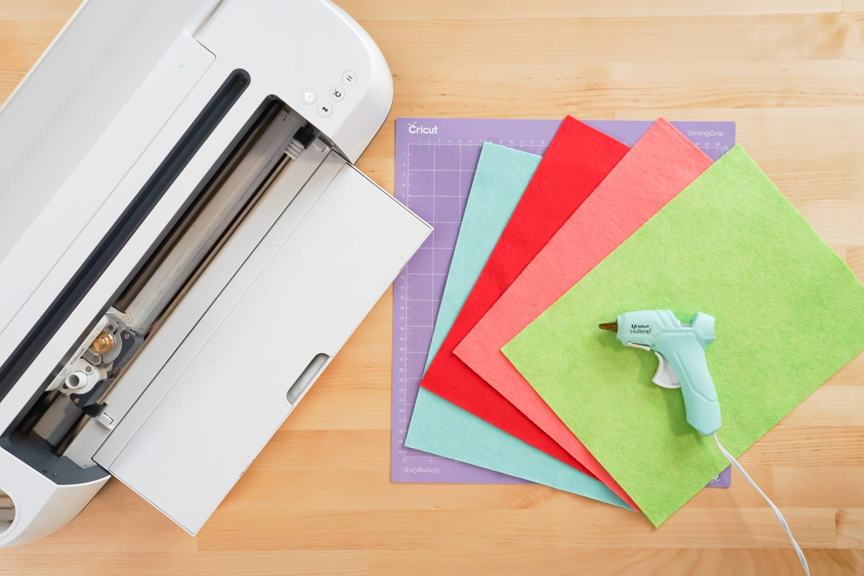 Supplies needed for this project: Cricut Maker, Cricut mat, felt, glue gun